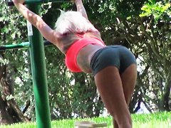 Setaming hot blonde Dee is working out outdoor