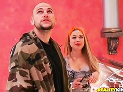 Busty blonde Charity Lane sucks dick in a car